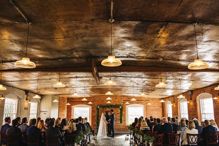 Industrial Wedding Ceremony at The West Mill | Greenery Floral Arch | S6 Photography