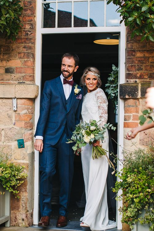 Bride in Charlie Brear Torum Dress & Adrianna Lace Jacket | Groom in Bespoke Michelsberg Tailoring Suit & Bow Tie | S6 Photography