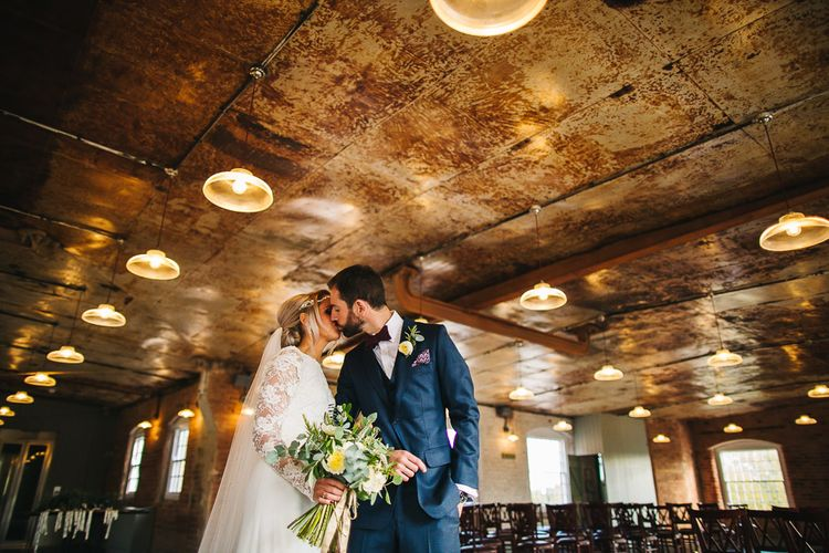 The West Mill Industrial Wedding Venue | Bride in Charlie Brear Torum Dress & Adrianna Lace Jacket | Groom in Bespoke Michelsberg Tailoring Suit & Bow Tie | S6 Photography