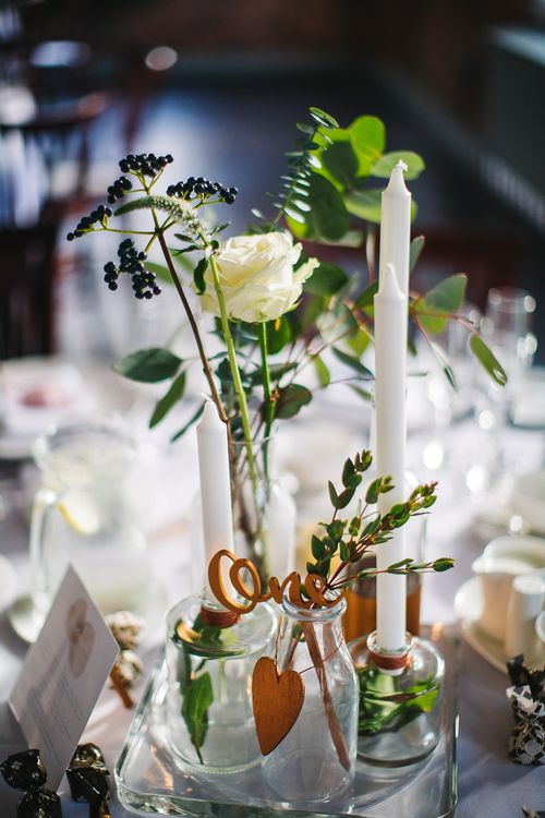 White & Green Flower Stems in Bottles with Copper Table Numbers | S6 Photography