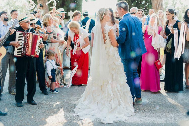 Bride in Monique L'Huillier Skirt, Bridal Separates | Groom in Light Blue Baldessarini Suit | Linda Nari Photography