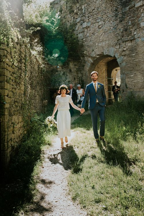 Boho Bride in Bespoke Lace Bridal Separates | Groom in Blue Suit | Chic Rustic French Wedding at Le Morimont Styled by Féelicité | Photography by Chloe