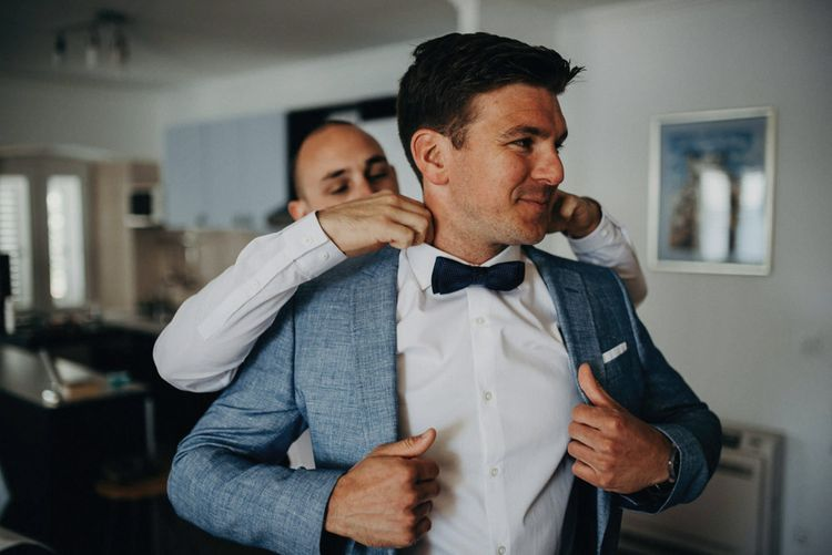 Groom in Hugo Boss Suit | Jere Satamo Photography