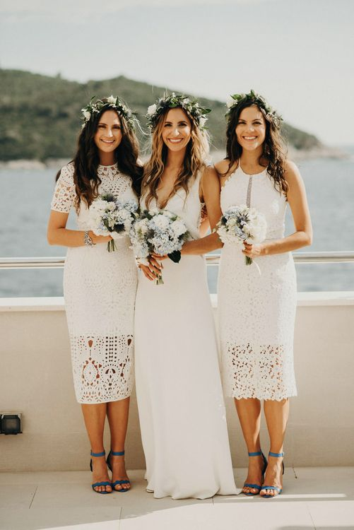 Bridesmaids in White Lace Dresses | Bride in Rime Arodaky Gown | Jere Satamo Photography