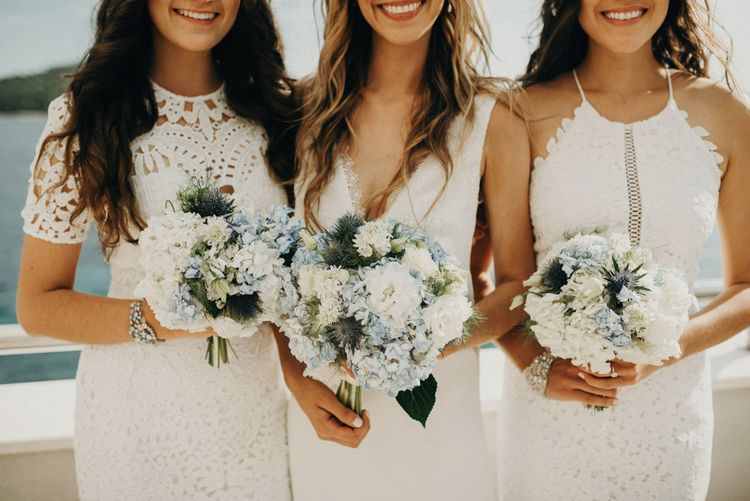 White & Blue Bouquets | Bridesmaids in White Lace Dresses | Bride in Rime Arodaky Gown | Jere Satamo Photography