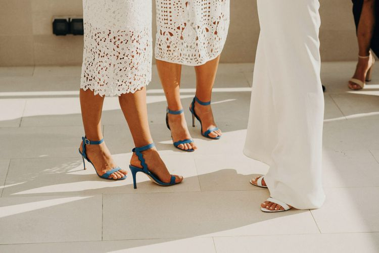 Blue Loeffler Randall Shoes | Bridesmaids in White Lace Dresses | Bride in Rime Arodaky Gown | Jere Satamo Photography