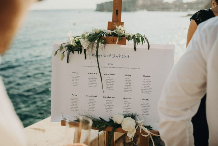 Table Plan with Greenery & White Flower Decor | Destination Croatia Wedding | Jere Satamo Photography