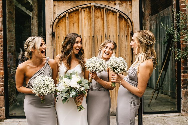 Bridesmaids in Grey ASOS Multiway Dresses | Bride in Martina Liana Bridal Gown from Coco and Kate | Gypsopila Bouquet | Alex Tenters Photography