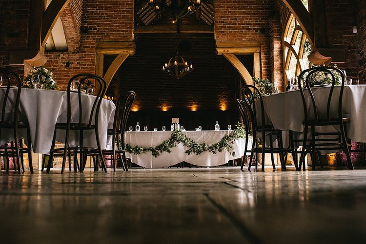 Greenery & White Top Table Floral Arrangement by Lilly White Florist | Alex Tenters Photography