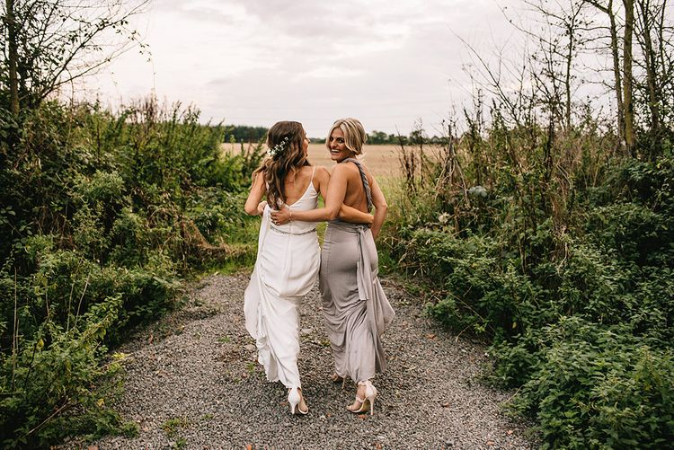 Bride in Martina Liana Bridal Gown from Coco and Kate | Bridesmaid in Grey ASOS Multiway Dress | Alex Tenters Photography