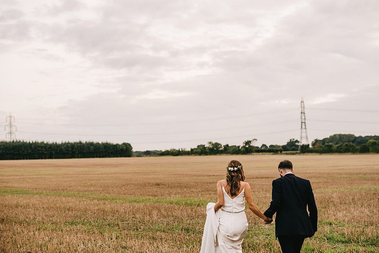 Bride in Martina Liana Bridal Gown from Coco and Kate | Groom in Reiss Bespoke Tailoring Suit | Alex Tenters Photography