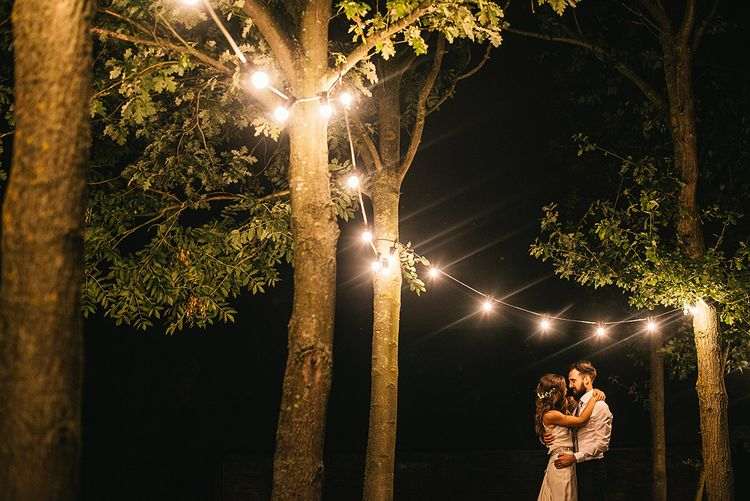 Festoon Lights | Bride in Martina Liana Bridal Gown from Coco and Kate | Groom in Reiss Bespoke Tailoring Suit | Alex Tenters Photography