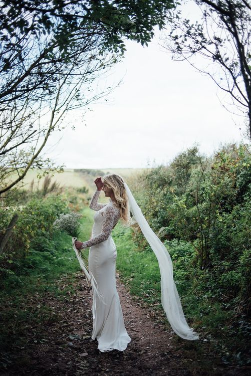 Bride In Bespoke Dress With Lace Long Sleeves & Deep V Back