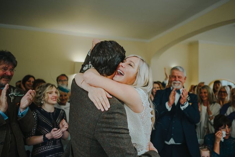 Wedding Ceremony with Bride in Anais Anette Savannah Bridal Gown & Groom in Walker Slater Tweed Suit