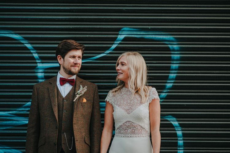 Urban Portraits with Bride in Anais Anette Savannah Bridal Gown & Groom in Walker Slater Tweed Suit