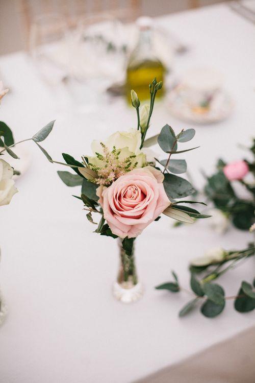 Roses In Bud Vases