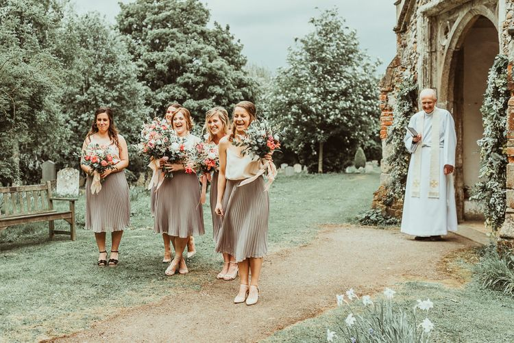 Bridesmaids in Pleated TFNC Skirts | DIY At Home Marquee Reception | Jess Soper Photography