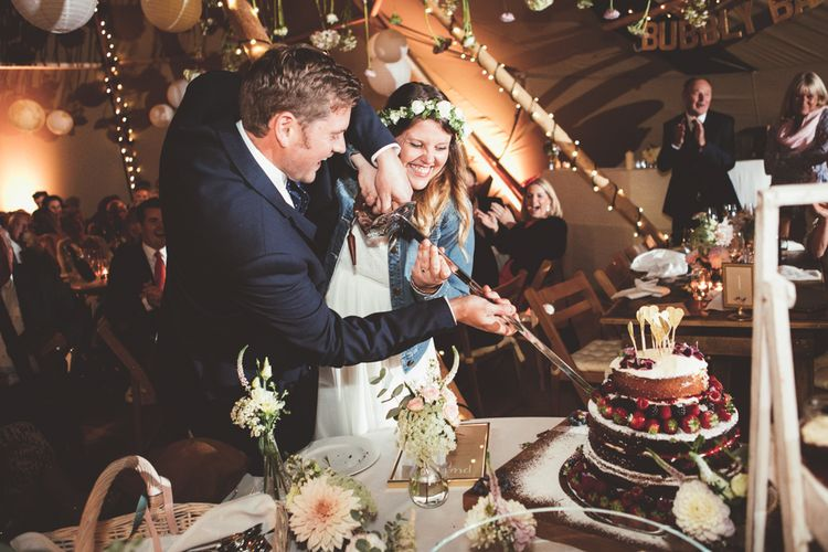 Cutting The Homemade Naked Wedding Cake | Bride in Something Old Something New Bridal Gown | Groom in Marks and Spencer Suit | Maryanne Weddings Photography