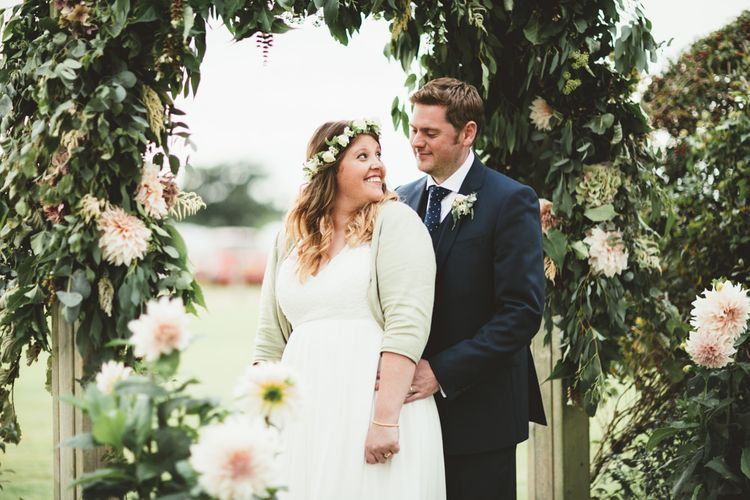 Floral Arch | Bride in Something Old Something New Bridal Gown | Groom in Marks and Spencer Suit | Maryanne Weddings Photography
