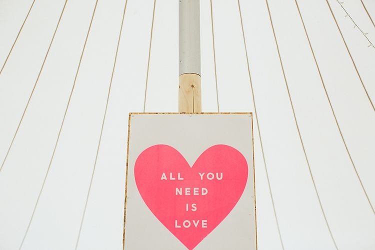 All You Need Is Love Sign | At Home Greenery Filled Marquee Wedding in Yorkshire | Craig Williams Photography