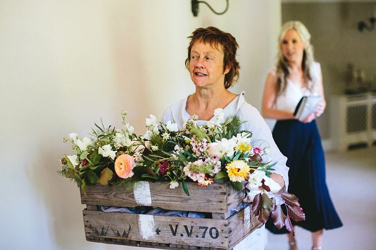 Wooden Crate of Wild Flower Bouquets | At Home Greenery Filled Marquee Wedding in Yorkshire | Craig Williams Photography