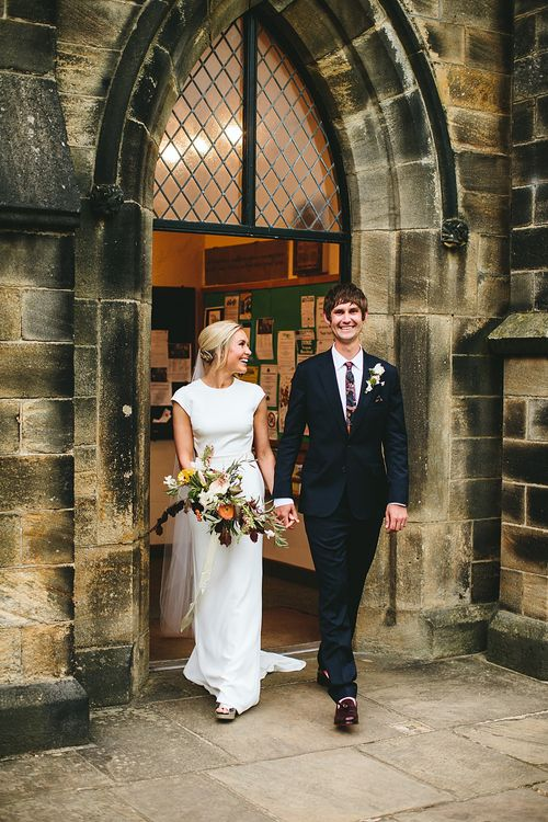 Wedding Ceremony | Bride in Bon Bride Bespoke Gown | Groom in Navy Paul Smith Suit | At Home Greenery Filled Marquee Wedding in Yorkshire | Craig Williams Photography
