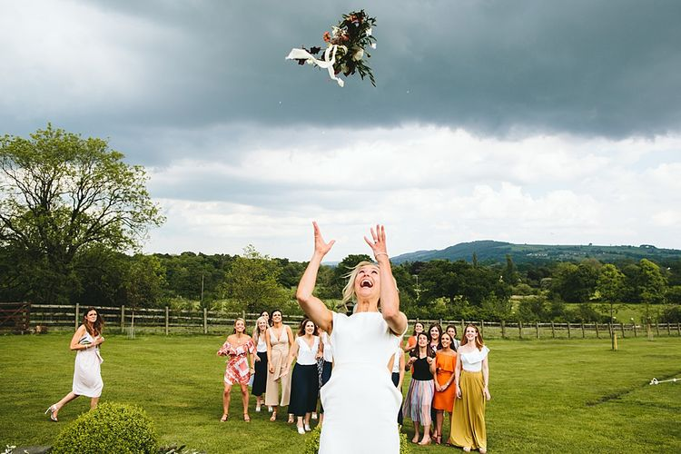 Bouquet Toss | At Home Greenery Filled Marquee Wedding in Yorkshire | Craig Williams Photography