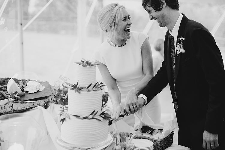 Cutting the Cake | At Home Greenery Filled Marquee Wedding in Yorkshire | Craig Williams Photography