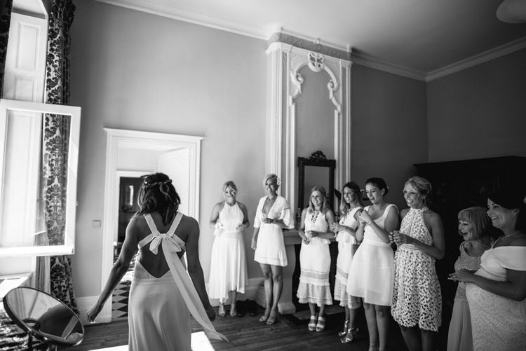 Bridesmaids In White Dresses From The High Street For A Valentino Rockstud Wedding Shoes For A Relaxed Intimate Wedding At Chateau De Lisse France With Bride In Delphine Manivet From The Mews Bridal With Images From McGivern Photography