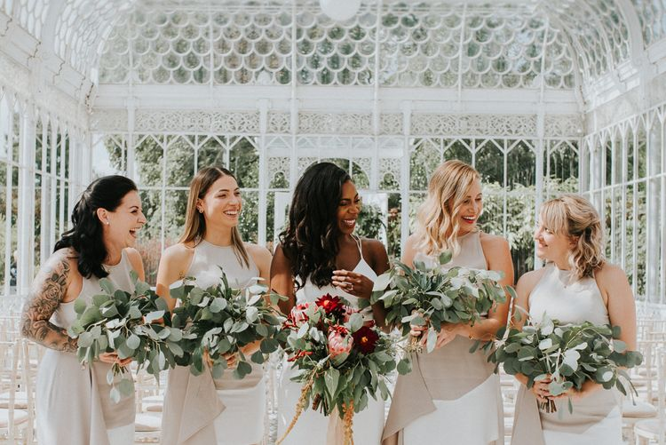 Bridal Party | Bridesmaids in White AQ/AQ Dresses | Bride in Charlie Brear Gown | Greenery & Protea Bouquets | Botanical Orangery Wedding at Horniman Museum & Gardens, London | Fern Edwards Photography