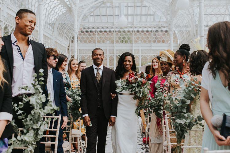 Wedding Ceremony | Bridal Entrance in Charlie Brear Gown | Botanical Orangery Wedding at Horniman Museum & Gardens, London | Fern Edwards Photography