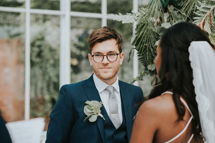 Wedding Ceremony | Groom at the Altar in Moss Bros Suit | Botanical Orangery Wedding at Horniman Museum & Gardens, London | Fern Edwards Photography