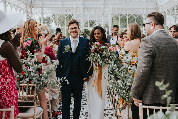 Wedding Ceremony | Bride in Charlie Brear Gown | Protea Bouquet | Groom in Moss Bros Suit | Botanical Orangery Wedding at Horniman Museum & Gardens, London | Fern Edwards Photography