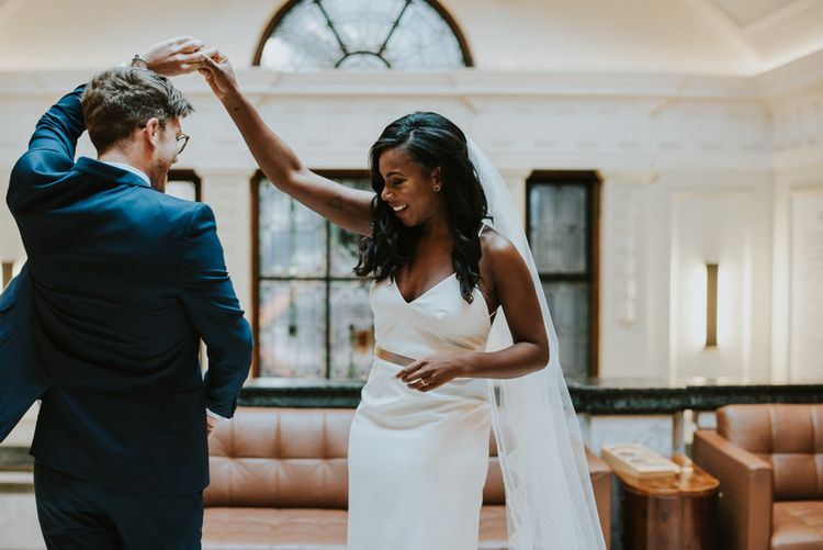 First Look | Bride in Charlie Brear | Groom in Moss Bros Suit | Botanical Orangery Wedding at Horniman Museum & Gardens, London | Fern Edwards Photography