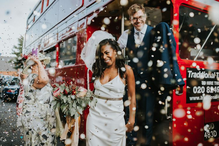 Confetti Exit | Bride in Charlie Brear Gown | Groom in Moss Bros Suit | London Bus Wedding Transport | Botanical Orangery Wedding at Horniman Museum & Gardens, London | Fern Edwards Photography