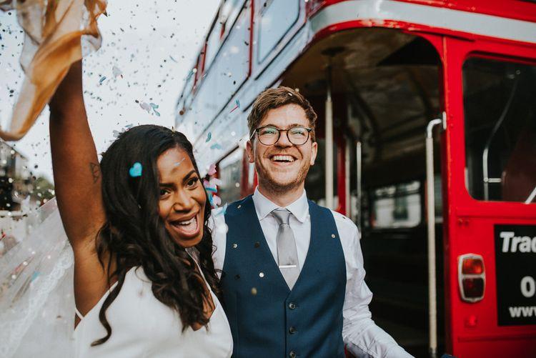 Bride in Charlie Brear Gown | Groom in Moss Bros Suit | London Bus Wedding Transport | Botanical Orangery Wedding at Horniman Museum & Gardens, London | Fern Edwards Photography