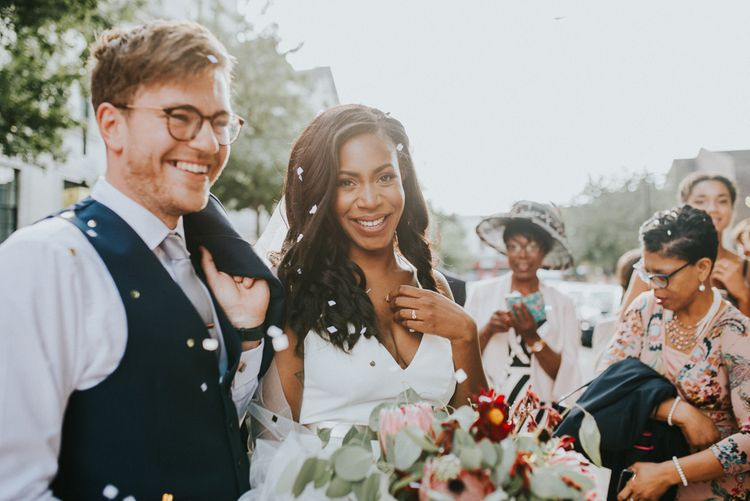 Bride in Charlie Brear Gown | Groom in Moss Bros Suit Botanical Orangery Wedding at Horniman Museum & Gardens, London | Fern Edwards Photography