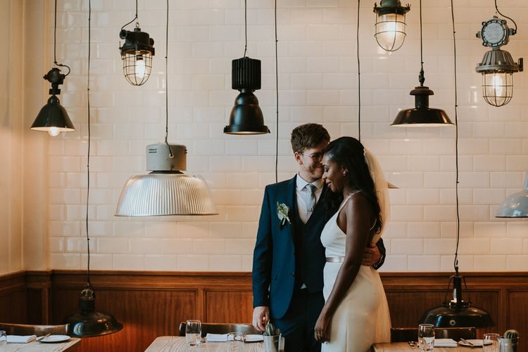 Bride in Charlie Brear | Groom in Moss Bros Suit | City Wedding at Town Hall Hotel, Bethnal Green | Fern Edwards Photography