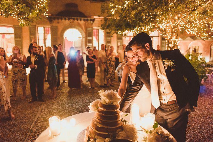 Cutting the Cake | Bride in Karen Willis Holmes Gown | Groom in Navy Peter Jackson Suit | Outdoor Destination Wedding at Villa Regina Teodolinda, Lake Como, Italy | Matt Penberthy Photography