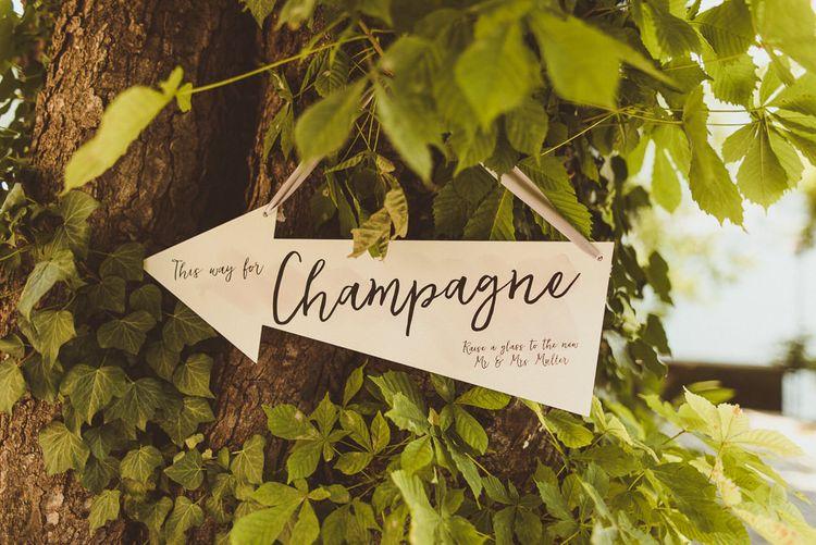 Wooden Direction Sign | Outdoor Destination Wedding at Villa Regina Teodolinda, Lake Como, Italy | Matt Penberthy Photography