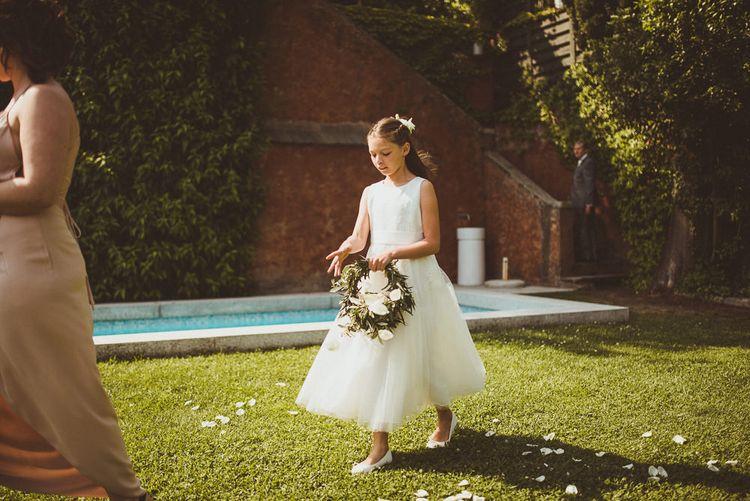 Flower Girl in Monsoon Dress | Wedding Ceremony | Outdoor Destination Wedding at Villa Regina Teodolinda, Lake Como, Italy | Matt Penberthy Photography