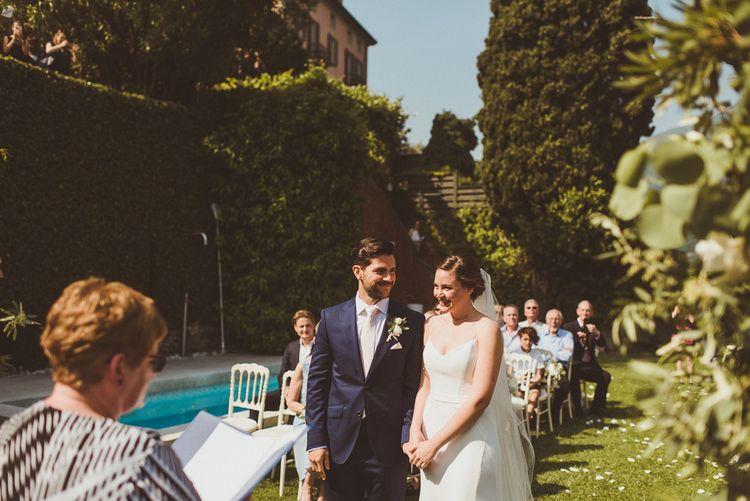 Wedding Ceremony | Bride in Karen Willis Holmes Gown | Groom in Navy Peter Jackson Suit | Outdoor Destination Wedding at Villa Regina Teodolinda, Lake Como, Italy | Matt Penberthy Photography
