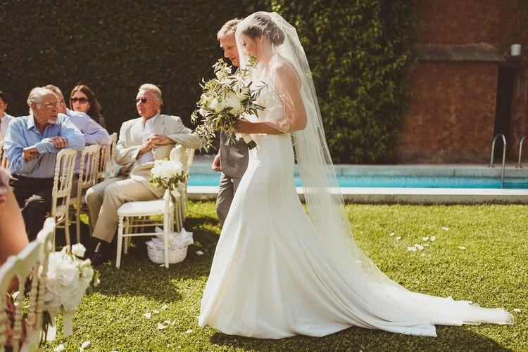 Bridal Entrance in Karen Willis Holmes Gown | Outdoor Destination Wedding at Villa Regina Teodolinda, Lake Como, Italy | Matt Penberthy Photography