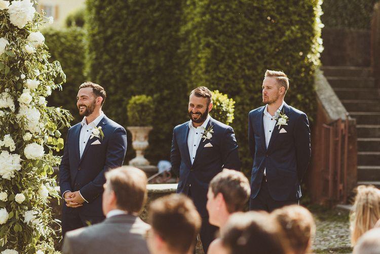 Wedding Ceremony | Groomsmen in Navy Peter Jackson Suits | Outdoor Destination Wedding at Villa Regina Teodolinda, Lake Como, Italy | Matt Penberthy Photography