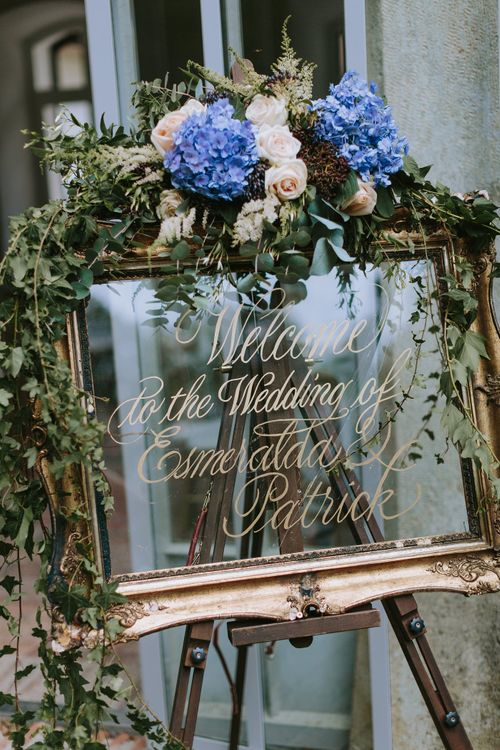 Gold Guilt Mirror Wedding Sign Decorated with Flowers