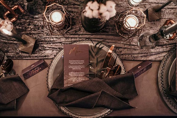 Place Setting | Candle Light Table Scape with Ghost Chairs & Glass Platters | Edison Lights | Industrial Wedding Inspiration at Victoria Warehouse in Manchester | Planning & Styling by The Urban Wedding Company | 2 Ducks Galleries