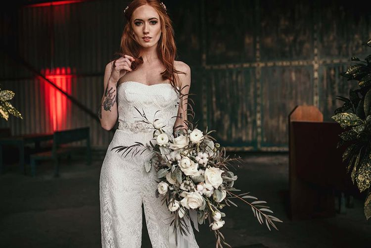 Stylish Bride in Jumpsuit | White Rose & Cotton Bud Bouquet | Industrial Wedding Inspiration at Victoria Warehouse in Manchester | Planning & Styling by The Urban Wedding Company | 2 Ducks Galleries