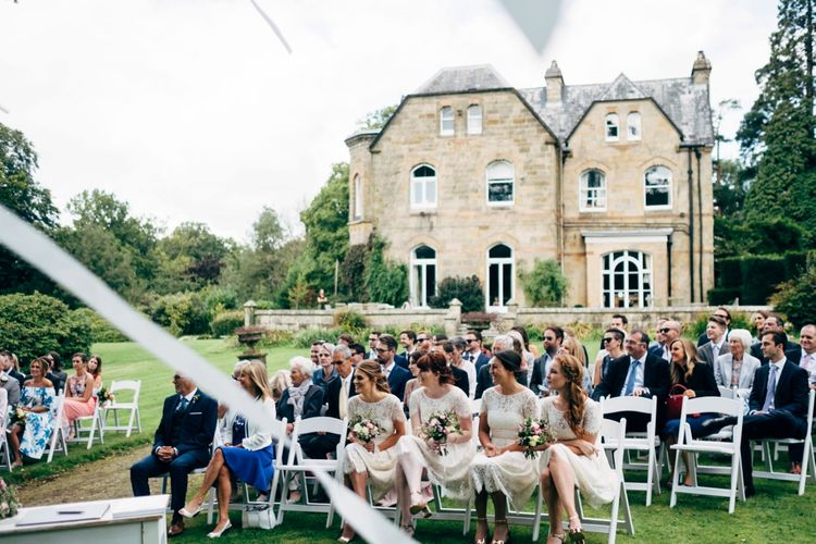 Bridesmaids in White Marks and Spencer Dresses | Outdoor Wedding Ceremony & Rustic Wedding at Patricks Barn, Sussex | Dale Weeks Photography | Love Filmed