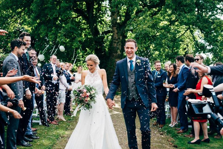 Confetti Moment | Bride in Watters Peyton Top & Gracia Skirt Bridal Separates | Groom in Next Suit | Outdoor Ceremony & Rustic Wedding at Patricks Barn, Sussex | Dale Weeks Photography | Love Filmed