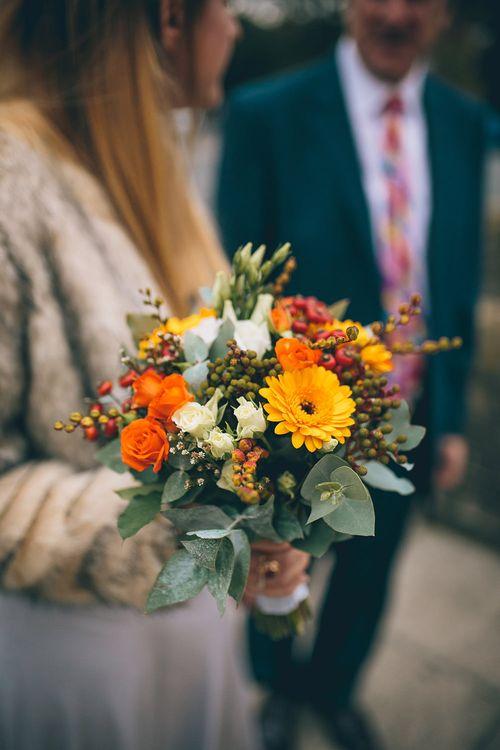 Bride in Ghost Dress, Fur Jacket & Autumnal Bouquet